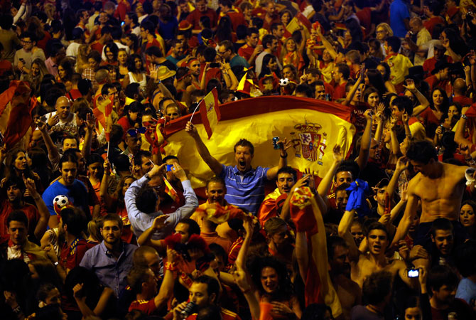 Spain's soccer fans celebrate Spain's victory over Italy at the end of the Euro 2012 final. ? Photo by Reuters