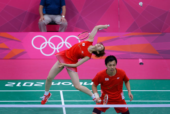 Japan's Reiko Shiota, left, and Shintaro Ikeda, play against Canada's Toby NG and Grace Gao, unseen, at a mixed doubles badminton match of the 2012 Summer Olympics, Sunday, July 29, 2012, in London. ? Photo by AP