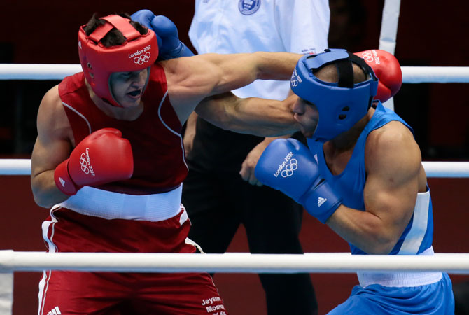 Colombia's Jeysson Monroy Varela, left, fights Iran's Ehsan Rouzbahani during a light heavyweight 81-kg preliminary boxing match at the 2012 Summer Olympics, Monday, July 30, 2012, in London. ? Photo by AP