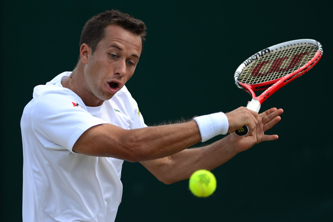 Germany's Philipp Kohlschreiber plays a backhand shot during his third round men's singles victory over Czech Republic's Lukas Rosol on day six of the 2012 Wimbledon Championships. ? Photo by AFP