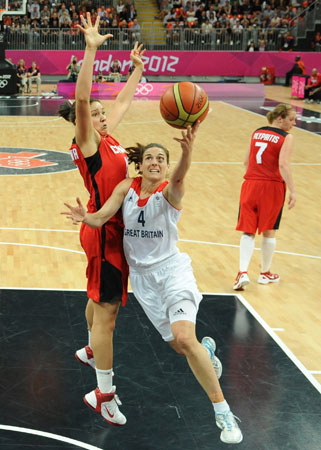 British guard Natalie Stafford, right, vies for the ball with Canadian forward Natalie Achonwa during their women's preliminary round group B basketball match at the 2012 Summer Olympics on Monday, July 30, 2012, in London. ? Photo by AP