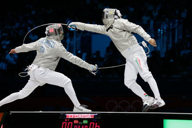 Italy's Diego Occhiuzzi, left, competes with Hungary's Aron Szilagy during the gold medal match in the men's fencing individual sabre at the 2012 Summer Olympics, Sunday, July 29, 2012, in London. ? Photo by AP