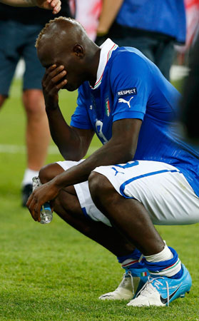 Italy's Mario Balotelli reacts after losing the Euro 2012 final against Spain. ? Photo by Reuters