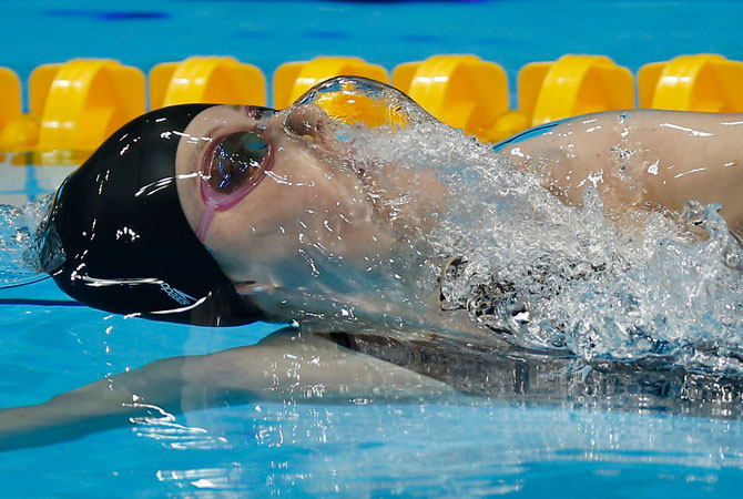 United States' Missy Franklin competes in the women's 100 meter backstroke semifinal at the Aquatics Centre in the Olympic Park during the 2012 Summer Olympics in London, Sunday, July 29, 2012. ? Photo by AP