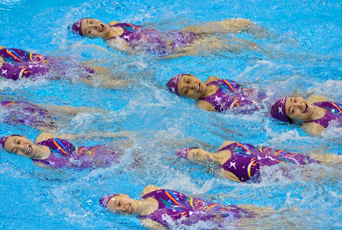 The Chinese synchronized swimming team trains at the Aquatics Centre in the Olympic Park in Stratford in east London July 24, 2012. Photo by Reuters