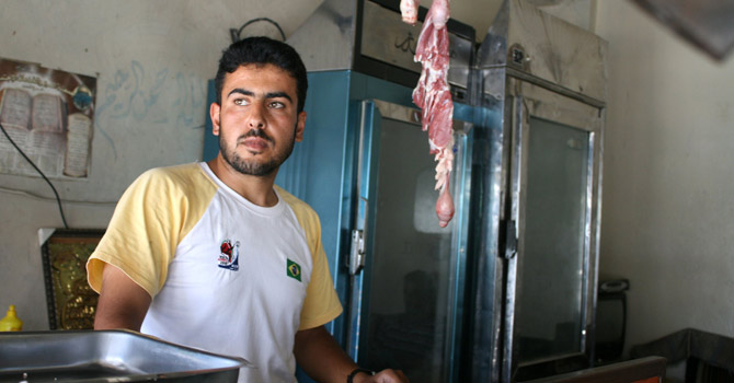 A Syrian butcher stands in his empty shop in the besieged city of Qusayr in the central province of Homs.—AFP Photo