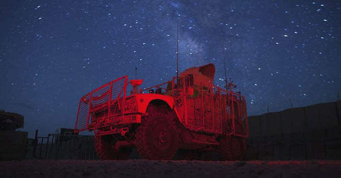 The Milky Way shines in the sky behind a Mine Resistant Ambush Protected (MRAP) vehicle parked at the entry to Forward Operating Base (FOB) Goode near the town of Gardez in Afghanistan's Paktia Province July 9, 2012.  REUTERS