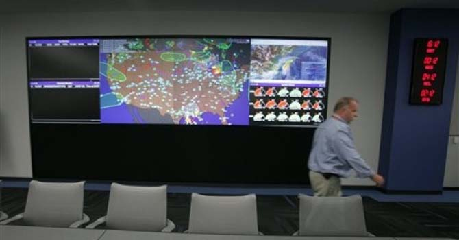 A U.S. map shows the active United Airline flights in the air on a large display monitor at United Airline's new Network Operations Center Monday, June 18, 2012, in Chicago. The center, which was relocated to Willis Tower in Chicago, oversees more than 5,600 flights per day with employees planning flights, forecasting,routing scheduling crews and working with air traffic control.