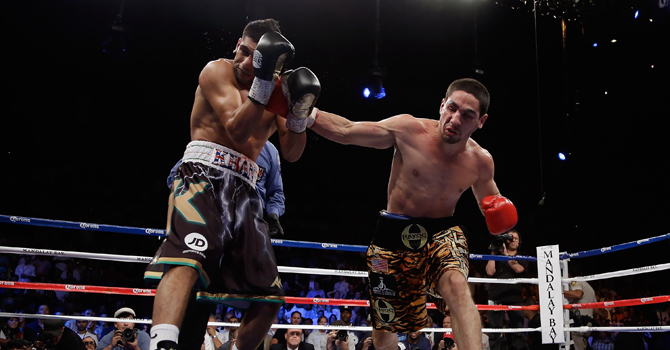 Danny Garcia (R) lands a right hand to the head of Amir Khan of Great Britain during their WBC/ WBA Super Lightweight and vacant Ring Magazine Junior Welterweight title fight at Mandalay Bay Events Center on July 14, 2012 in Las Vegas, Nevada.