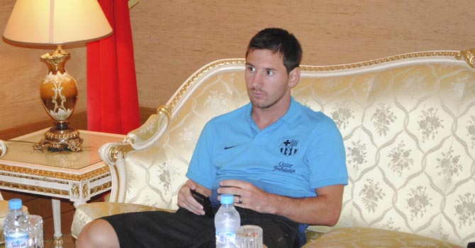 FC Barcelona's player Lionel Messi sits in a hotel in Tangier, July 28, 2012. FC Barcelona will be playing the second pre-season friendly soccer match against Morocco's Raja Club Athletic tonight. REUTERS/Stringe