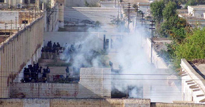 Police fires teargas shells in Central Prison Hyderabad during a search operation.—File Photo