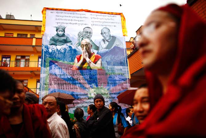 Tibetans gather to mark the birthday of their spiritual leader the Dalai Lama at a monastery. ? Photo by AP
