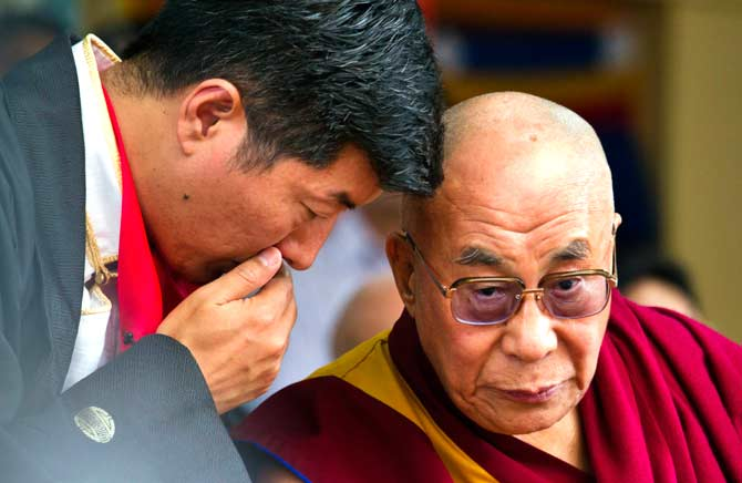 The Dalai Lama, right, listens to Lobsang Sangay, prime minister of Tibet's government in exile, during a function at the Tsuglakhang temple in Dharmsala. ? Photo by AP