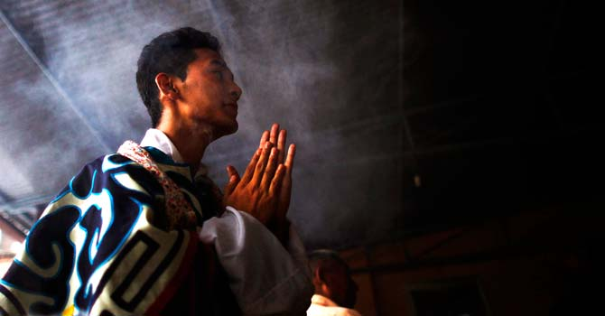 A Tibetan man prays at a monastery in Katmandu. ? Photo by AP