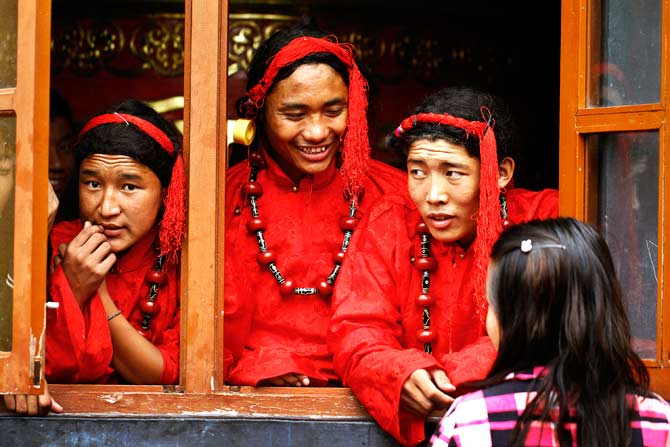 Tibetans in traditional costumes wait to perform at a cultural show in Katmandu. ? Photo by AP