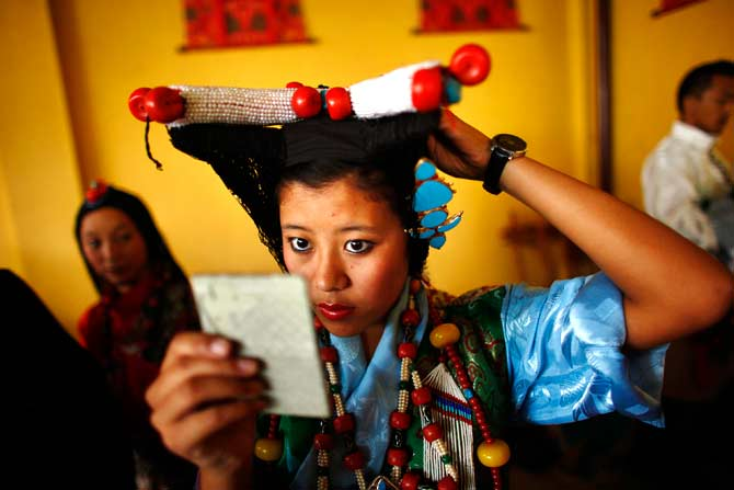 Tibetan school girl prepares to perform at a cultural show in Katmandu. ? Photo by AP