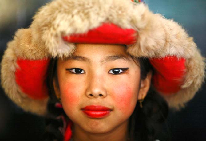 A Tibetan girl dressed in traditional attire is pictured during the 77th birthday celebration of the exiled spiritual leader the Dalai Lama in Kathmandu. ? Photo by Reuters