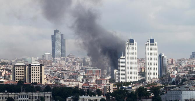Dark clouds of smoke billowing over the Besiktas district of Istanbul, after a fire broke out at a 42-storey building.—AFP Photo