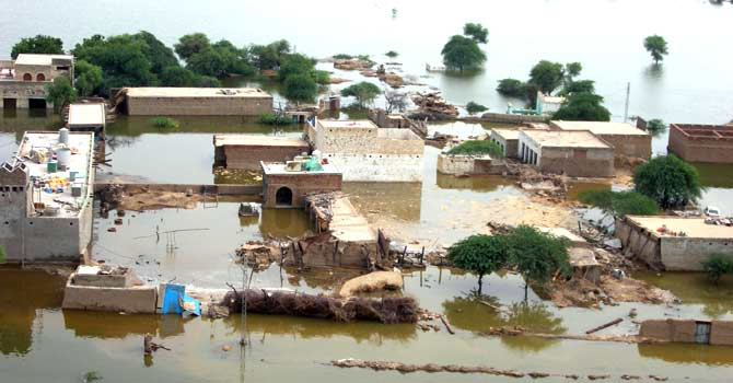 An aerial view from an army rescue helicopter shows the remote flood-affected Pakistani town Dera Alayar on August 15, 2010. Experts have warned that Pakistan's flood forecasting system is flawed. – File photo by AFP