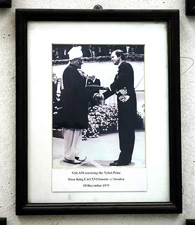 A photograph shows Professor Abdus Salam receiving the Nobel Prize from King Carl XVI Gustav of Sweden on December 10, 1979, is displayed at the government college where professor Salam taught in Lahore.