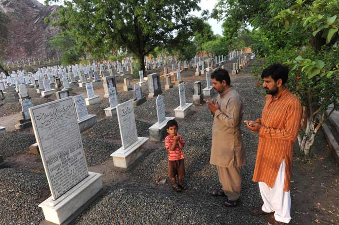Local residents offer prayers at the grave of Professor Abdus Salam.