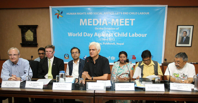 Former lawmaker and 'kamlari' girl, Shanta Chaudhary (3R) attends a press conference of commitment to eliminate child labour from Nepal, in the capital Kathmandu.—AFP Photo