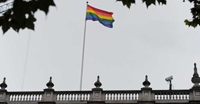 The rainbow flag, symbolising gay pride, flies above the Cabinet Office in central London, on July 6, 2012. The British government on Friday hoisted the rainbow flag symbolising gay pride over one of its ministries for the first time. Deputy Prime Minister Nick Clegg requested the flag be flown on Whitehall, the central London street that houses several ministries, ahead of the World Pride parade celebrating gay rights in the British capital on Saturday.AFP PHOTO / CARL COURT