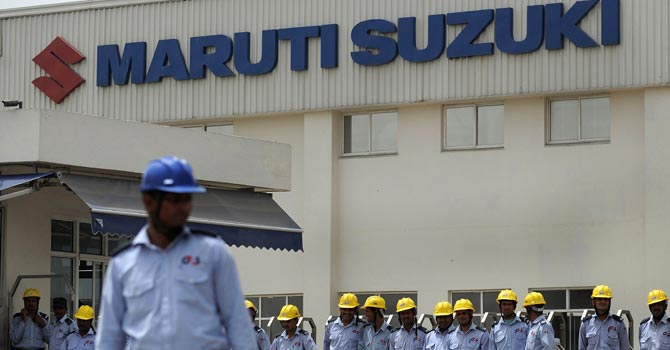 Indian private security guards stand in front of the main gate of Maruti Suzuki Production Facility in Manesar.—AFP Photo