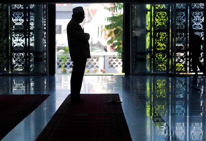 An Indonesian Muslim attends prayer at Baiturrahman mosque in Banda Aceh. ? Photo by AFP