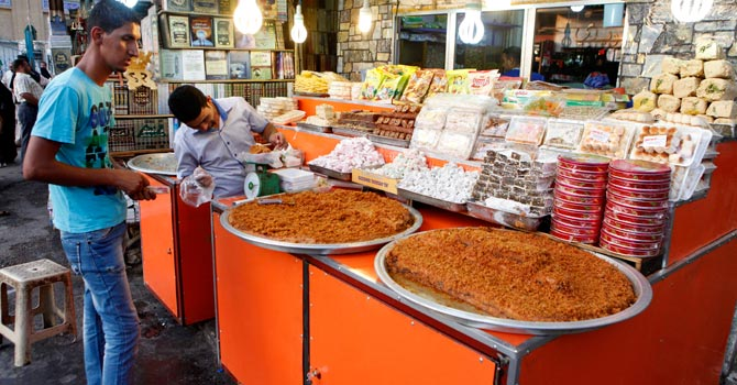 Iraqis shop for food in preparation for the Muslim fasting month of Ramadan.—AP Photo