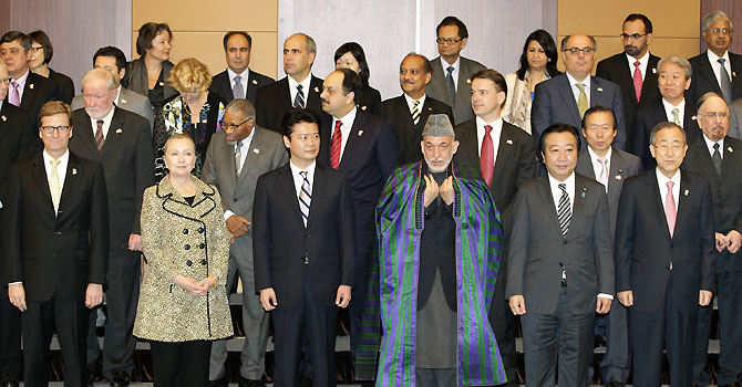 From left to right front row: German Foreign Minister Guido Westerwelle, U.S. Secretary of State Hillary Rodham Clinton, Japanese Foreign Minister Koichiro Gemba, Afghan President Hamid Karzai, Japanese Prime Minister Yoshihiko Noda, and U.N. Secretary-General Ban Ki-moon pose for a group photo with fellow participants of an international conference on Afghan civilian assistance, at a hotel in Tokyo on Sunday, July 8, 2012.(AP Photo/Shizuo Kambayashi)