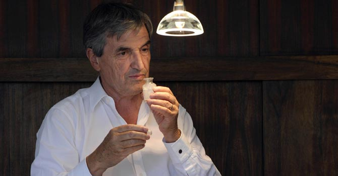 Jean-Claude Ellena, using perfume smelling strips at his home in the French southeastern city of Cabris.—AFP Photo