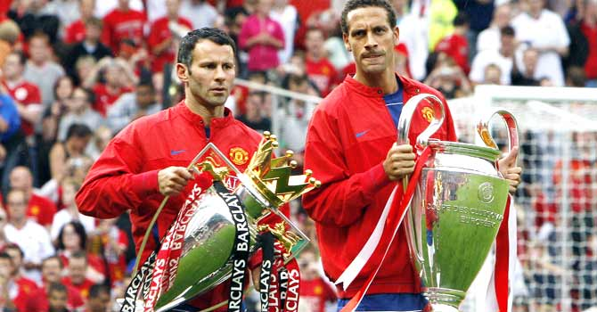 Ryan Giggs and Rio Ferdinand hold the Champions League and English Premiership trophies, August 2008. Manchester United are the most successful club in English football. – File photo by AFP