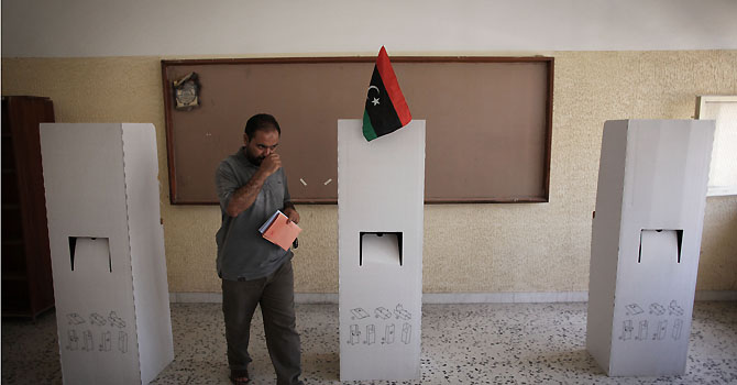 A Libyan man leaves a voting booth to cast his ballot at a polling station in the former loyalist stronghold district of Abu Salim in Tripoli, Libya, Saturday, July 7, 2012. Jubilant Libyans marked a major step toward democracy after decades of erratic one-man rule, voting Saturday in the first parliamentary election after last yearâ??s overthrow and killing of longtime dictator Moammar Gadhafi. But the joy over the historic vote was tempered by boycott calls, the burning of ballots and other violence in Libyaâ??s restive east.(AP