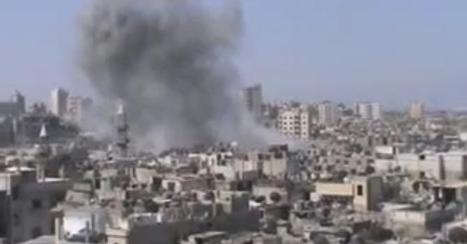 his image made from video provided by Shaam News Network Friday, July 6, 2012, purports to show shelling in Homs, Syria. (AP Photo