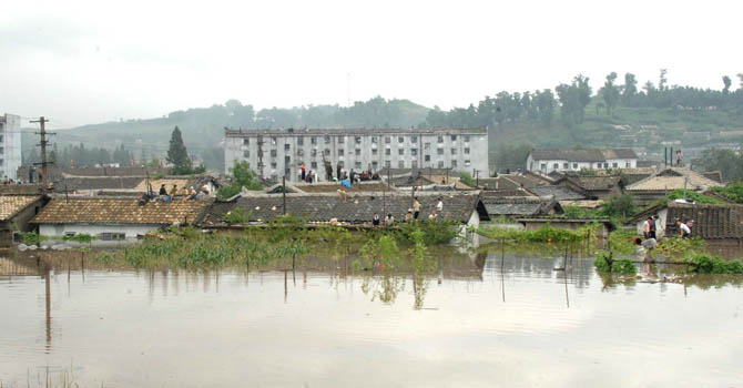 This picture, taken by North Korea's official Korean Central News Agency on July 30, 2012 shows houses being flooded at Anju city in South Phongan province, caused by typhoon and downpour.   AFP