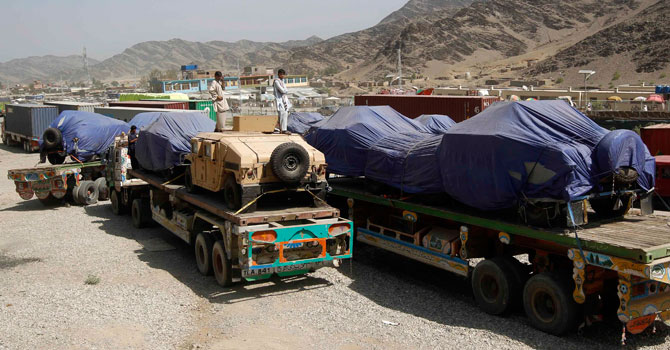 Trucks containing Nato supplies. — Reuters Photo