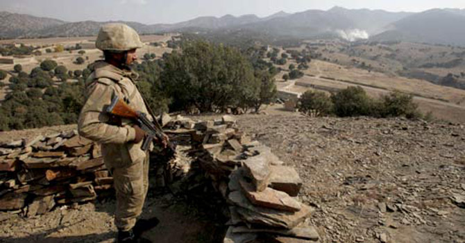 Pakistani soldier standing guard at Pak-Afghan border.—File Photo