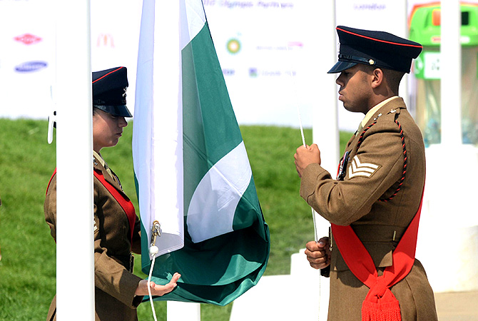 Military personnel raise the flag of Pakistan during the flag raising ceremony.
