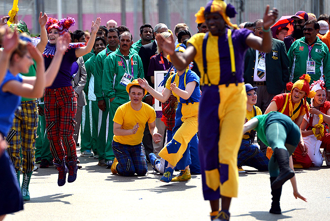 Pakistan officials and athletes watch as dancers perform.