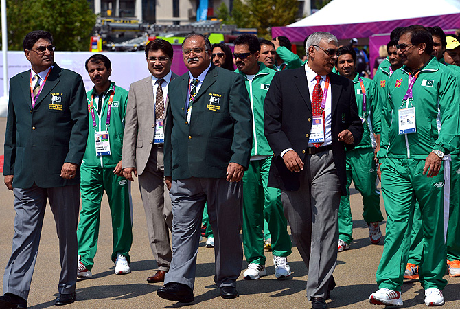 Pakistani officials and athletes during a parade at the Olympic village in London.