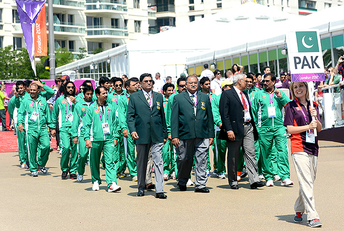 Officials and athletes from Pakistan march during the flag raising ceremony.