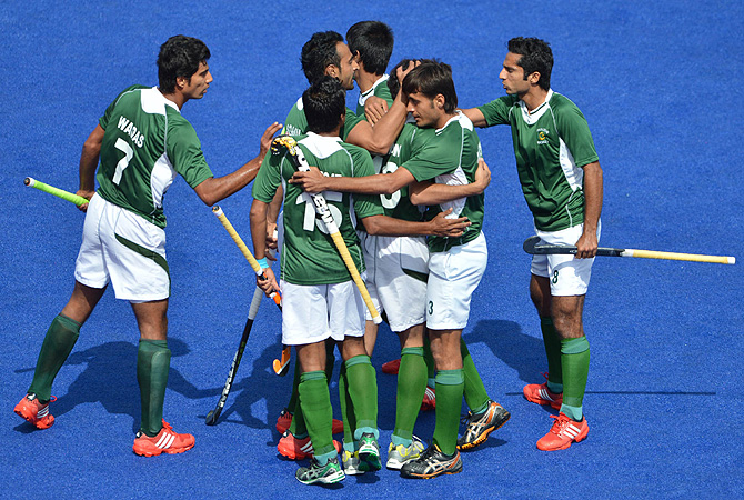 Pakistan's Rehan Butt is congratulated by teammates after scoring a goal. -Photo by AFP