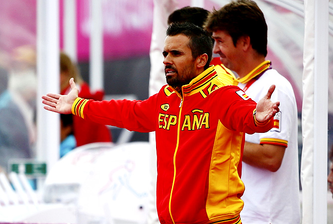 Spain's coach Daniel Martin Santos reacts during their men's Group A hockey match against Pakistan. -Photo by Reuters