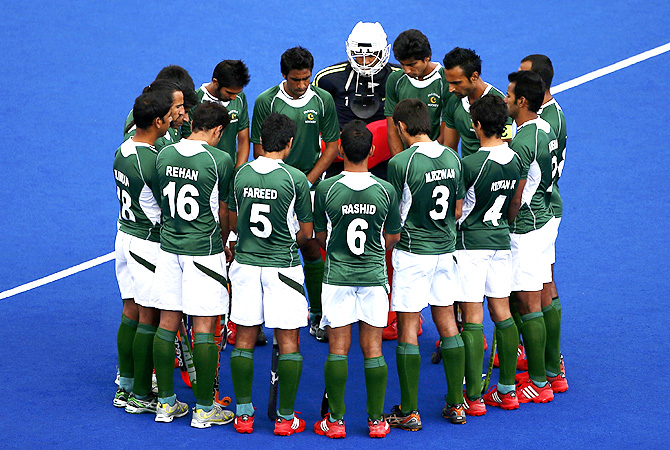 Pakistan's players huddle before their men's Group A hockey match against Spain. -Photo by Reuters