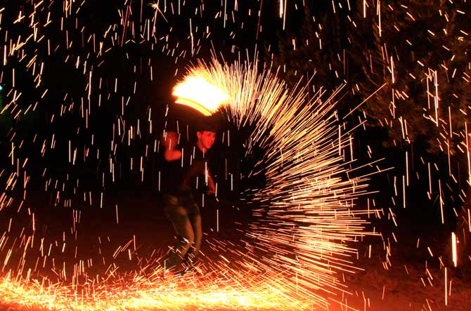 A Palestinian boy plays with fireworks as he celebrates the start of Ramazan in the West Bank city of Nablus. ? Photo by AP