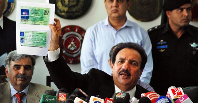 Federal Minister for Interior Senator A Rehman Malik showing the details of the NIC of Muhammad Ali Asad during a press conference regarding the fake passport allegations, at Ministry of Interior. ONLINE PHOTO