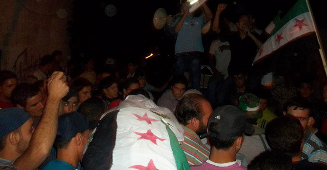 Residents carry the coffin of a man.—Reuters Photo