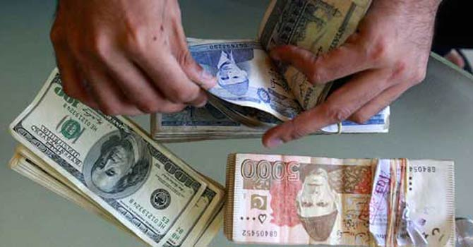 A trader counting Pakistani rupees.—File Photo