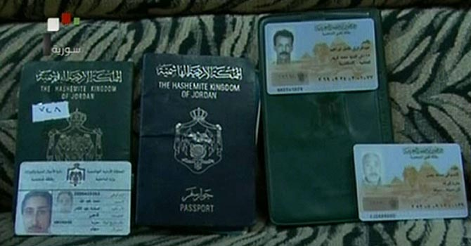 "An image grab taken from footage broadcast by Syrian state TV on July 22, 2012 shows Jordanian and Egyptian passports and ID cards which were allegedly found on the bodies of gunmen killed during clashes with Syrian security forces in the Qabun district of the capital Damascus. Feared forces led by President Bashar al-Assad's brother used helicopter gunships in a new assault on rebels in Damascus, activists said, as clashes also raged in Syria's second city Aleppo. AFP PHOTO / HO / SYRIAN TV == RESTRICTED TO EDITORIAL USE - MANDATORY CREDIT ""AFP PHOTO / HO / SYRIAN TV"" - NO MARKETING NO ADVERTISING CAMPAIGNS - DISTRIBUTED AS A SERVICE TO CLIENTS - AFP IS USING PICTURES FROM ALTERNATIVE SOURCES AS IT WAS NOT AUTHORISED TO COVER THIS EVENT, THEREFORE IT IS NOT RESPONSIBLE FOR ANY DIGITAL ALTERATIONS TO THE PICTURE'S EDITORIAL CONTENT, DATE AND LOCATION WHICH CANNOT BE INDEPENDENTLY VERIFIED =="